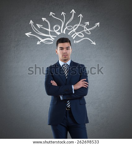 Businessman with arrows drawn on a wall overhead. Many ways, strategy, choices concept