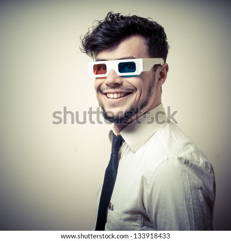 businessman with 3d eyewear on gray background