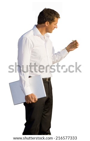 Businessman with laptop looking at hay
