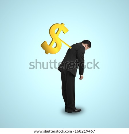 Businessman with money symbol winder on his back, isolated in green background