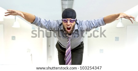Businessman with swimming gear in a pool