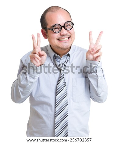 Businessman with victory sign gesture
