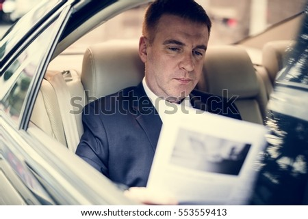 Businessman Working Busy Car Inside