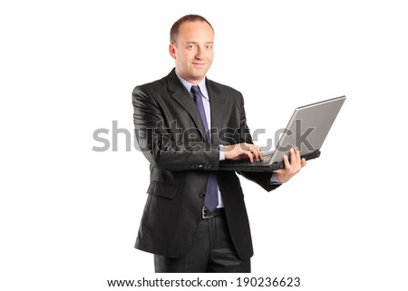 Businessman working on laptop isolated on white background