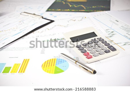 Businessman working on the calculator and his laptop to analyze the investment charts, Accounting and financial concept