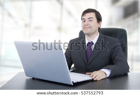 businessman working with is laptop, at the office