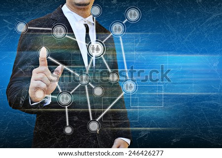 Businessman works with business and technology Network Display