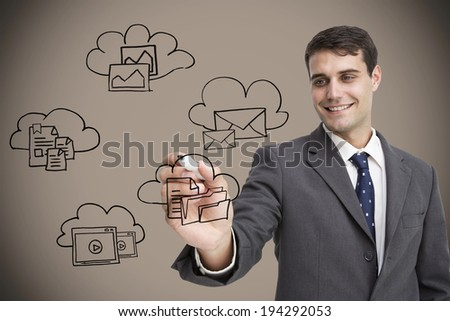 Businessman writing doodle against grey background with vignette