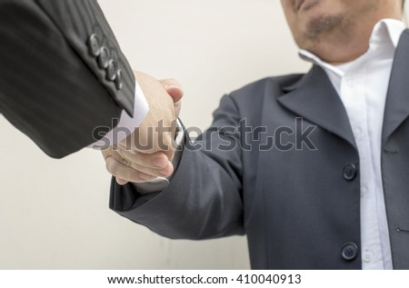 Businessmen shaking hands making an agreement, business handshake