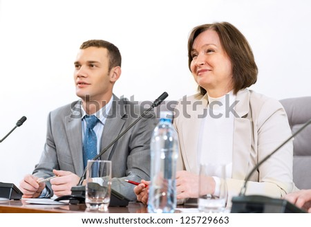 businessmen sitting in a chair at the table, communicate at the conference