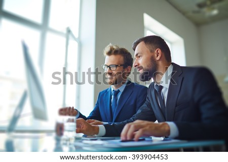 Businessmen working with computer in team
