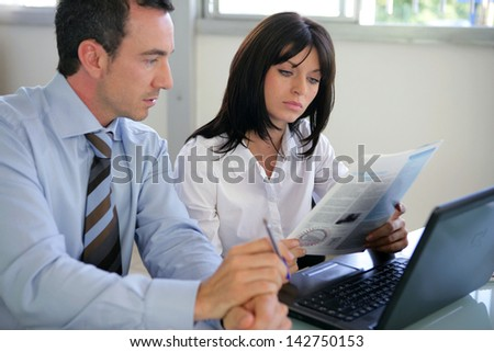 Businesspeople going over document