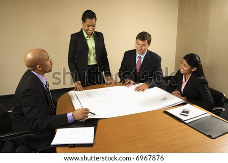 Businesspeople having meeting at conference table.