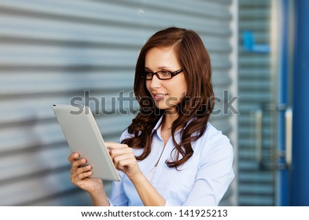 Businesswoman browsing the internet using her tablet