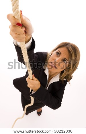 Businesswoman climbing up a rope