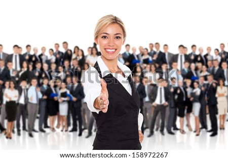 businesswoman handshake, human resource leader hire hold hand shake welcome gesture, young business woman happy smile over big group of businesspeople crowd background