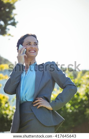 Businesswoman having a phone call outside on the terrace