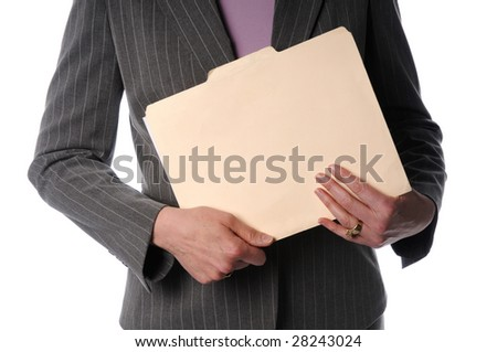 Businesswoman holding folder, cropped view