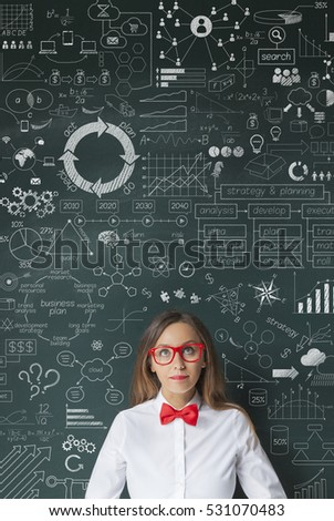 Businesswoman idea concept on blackboard