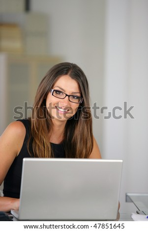 Businesswoman in the office with laptop