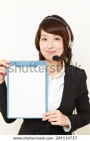 businesswoman of call center with message board