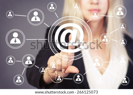 Businesswoman pressing online messaging mail icon