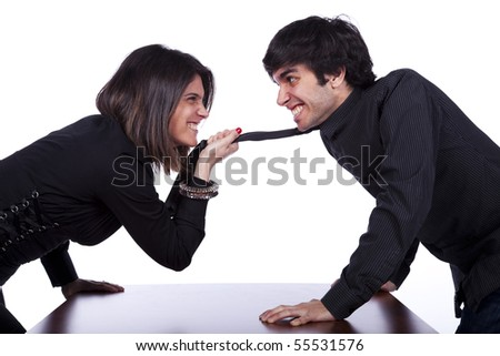 businesswoman pulling the businessman necktie at the office