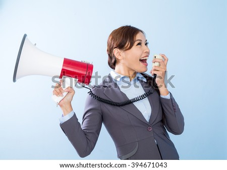 Businesswoman shouting with loudspeaker
