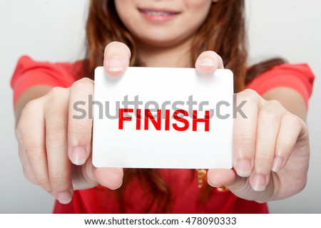 Businesswoman showing card with finish message,