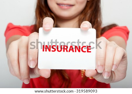 Businesswoman showing card with INSURANCE message