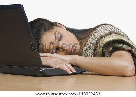Businesswoman sleeping in an office
