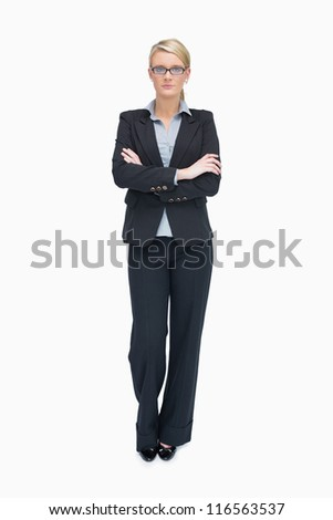 Businesswoman standing with folded arms and cocked leg