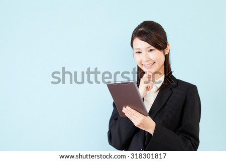 Businesswoman tablet Internet smile