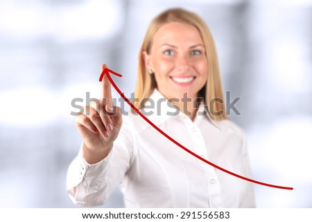 Businesswoman  touching a   virtual Graph by hand.  Blue background beside