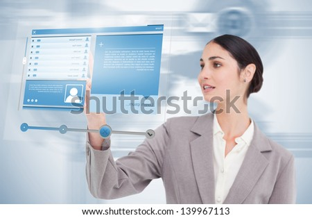 Businesswoman using futuristic hologram to view social media profile on blue background