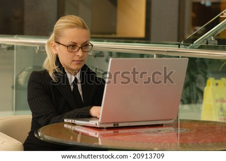 businesswoman working at her laptop  workaholic