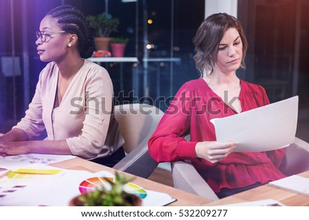 Businesswomen working on at desk in the office