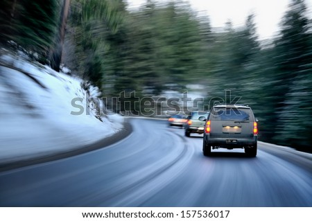 Busy road in winter evening on a mountain region
