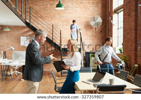 Busy trendy office with business people achieving success
