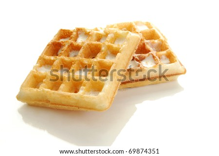 Buttered Belgium waffles on a white countertop