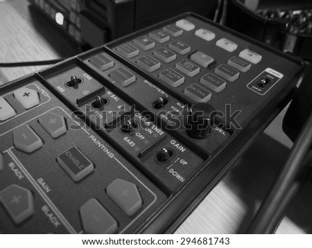 button on the control panel television equipment. black and white photo
