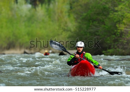 BUZAU, ROMANIA - APRILL 09, 2016: Athletes compete during 2016 Buzau X racee kayak endurance race in Buzau, Romania, aprill 09, 2016.