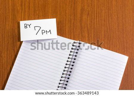 By 7 PM; White Blank Documents with Small Message Card.