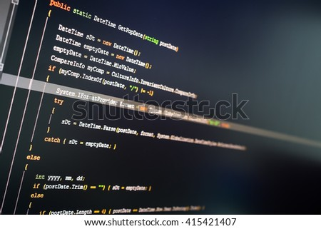C# computer language source code on computer monitor.