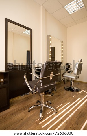 Barber makes girl hairstyle beauty salon stock photo for Armoire salon design