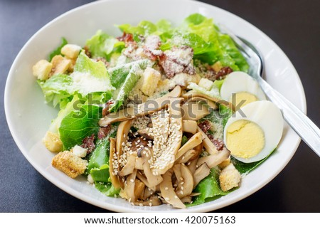 Caesar salad in a white bowl.