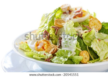 Caesar salad, isolated on white.