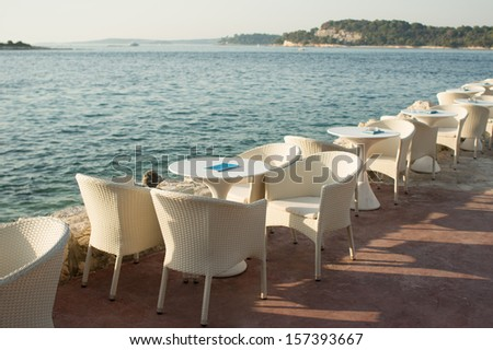 cafe tables by the sea