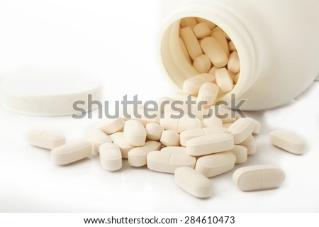 calcium tablets on white background