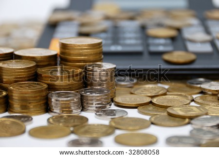 Calculator and different coins - financial symbol ...
